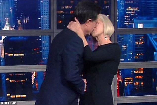 Helen Mirren kisses Stephen Colbert